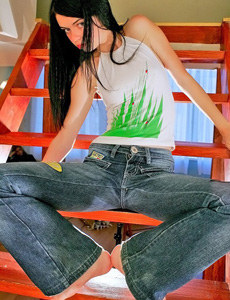 Brunette teen wears tight blue jeans