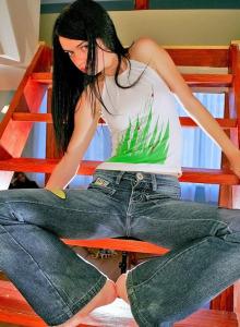 Brunette teen wears tight blue jeans