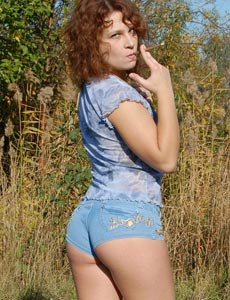 Puffy nipples chick with sexy apple tight ass in jeans shorts is smoking in the park