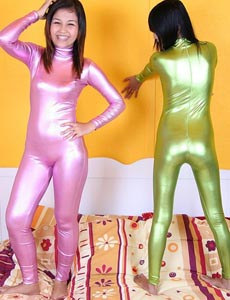 Asians in shiny outfits and pantyhoses