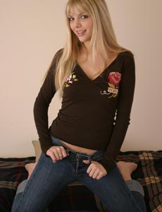 Exciting blonde in tight blue jeans