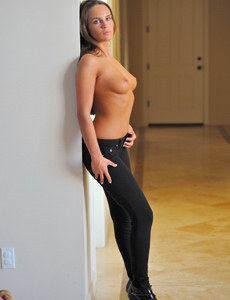 Busty girl in tight black jeans in sensual sunset curves