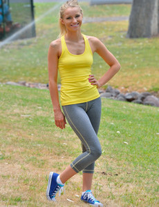 Sexy blonde in tight grey spandex with yellow top is flashing amazing tits with puffy nipples outdoor