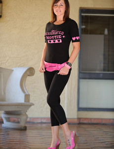 Exciting brunette in tight black suit