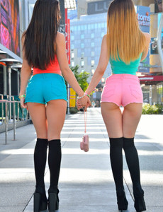 Two sexy girls wears petite colourful shorts on tasty apple asses and cameltoe