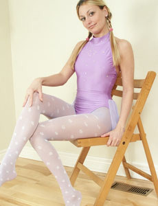 Exciting girl in sexy white pantyhose and spandex suit