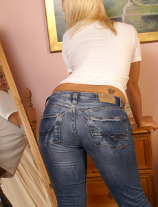 Sexy blonde wears panyhose under tight blue jeans