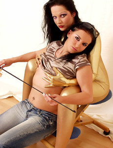 Two girls - one in shiny gold lycra, other in denim jeans