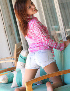 Sexy hottie in jeans shorts and pink plaid shirt