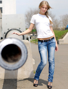 Sexy young blonde is outside in tight denim jeans