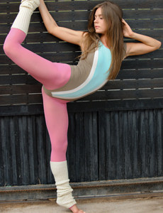 Pretty sexy girl in pink spandex has maximum fitness