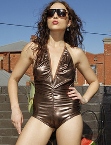 Tight bronze shiny spandex girl with cameltoe and puffy nipples