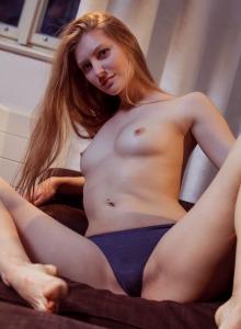 Beautiful baby dressed in orange jeans has erected nipples