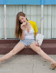 Sexy teen is outside wearing shorts