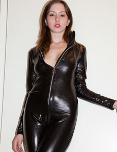 Passionate chick wears latex suit