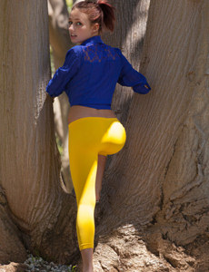 Petite baby is outside in yellow spandex