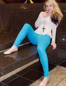 Tasty blonde wears light blue jeans