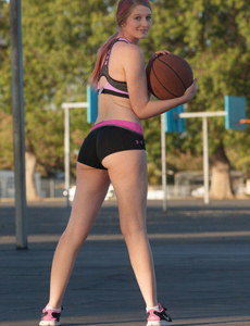 Sexy baby is playing basketball in tight sports top and petite sports shorts flashing her sexy tits and ass