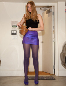 Perfect beauty is dressed tight in magenta skirt with magenta pantyhose and high heels