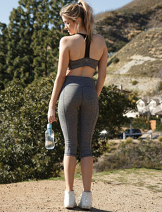 Workout barbie is outside in tight grey sports suit