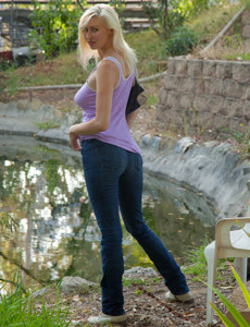 Amazing blonde is outside in tight denim jeans