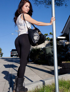 Hot brunette in black tight pants and the sun