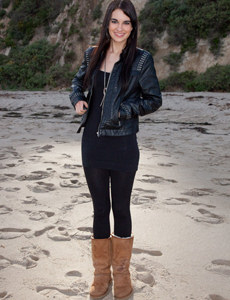Hot brunette baby dressed in tight black pants