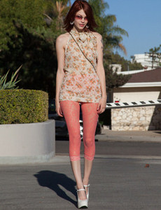 Exciting redhead wears pink lace spandex outside