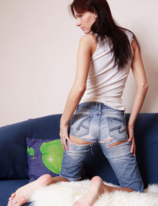 Tasty young girl in tight blue jeans has hairy beaver