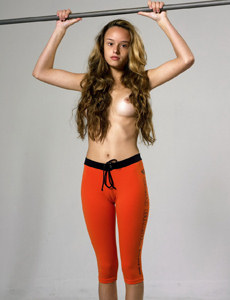 Amazing girl with perfect body wearing orange spandex with cameltoe