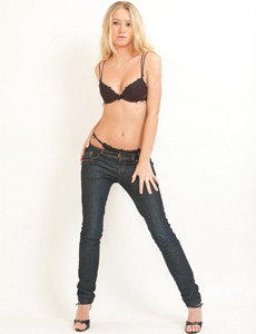 Young blonde in sexy black underwear and tight blue jeans