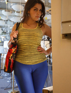 A girl visits shop in blue spandex with cameltoe